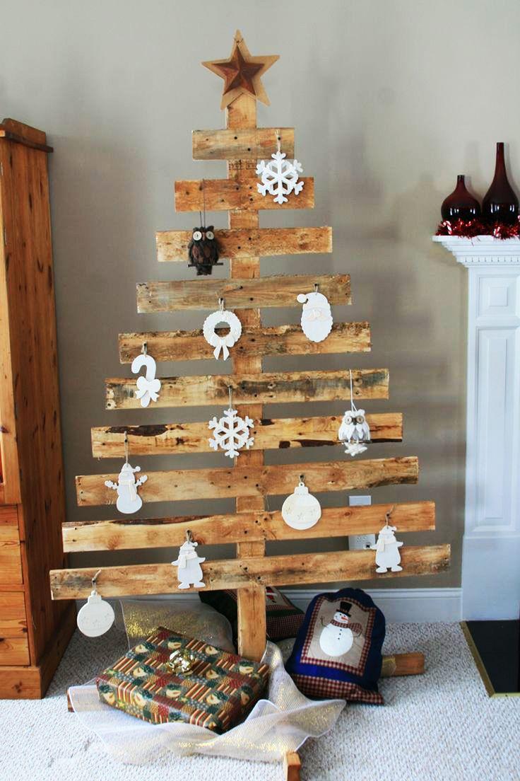 Fabriquer Des Sapins De Noel faire un sapin de noël en utilisant une palette de bois